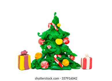 Plasticine handmade present and fir-tree decoration. Christmas and New Year