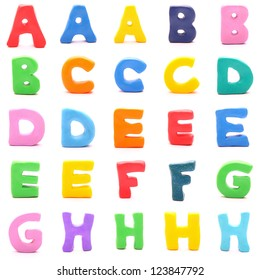 """plasticine letters standing on white background (1 of 3 - from """"a"""" to """"h"""")"""