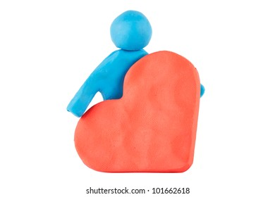 Plasticine man with plasticine heart on the white background
