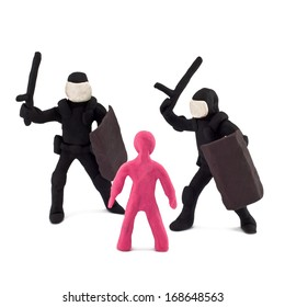 Plasticine police beating of children isolated on white background
