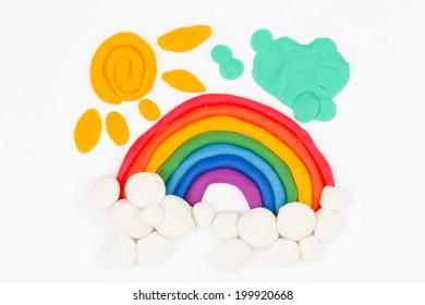 Plasticine rainbow, clouds - Stock Image macro.