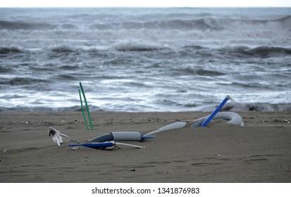 plasting tubing on the beach of Versilia coastline on wintertime