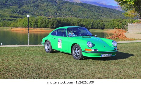 PLASTIRAS LAKE, GREECE, SEPTEMBER 27, 2019. Classic german car Porsche 911 T of 1972, during a classic rally, with Plastiras lake in the background.