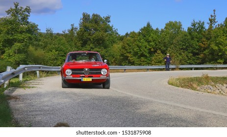 PLASTIRAS LAKE, GREECE, SEPTEMBER 27, 2019. Classic italian car Alfa Romeo GT 1300 of 1972, during a classic rally at lake Plastiras in central Greece.