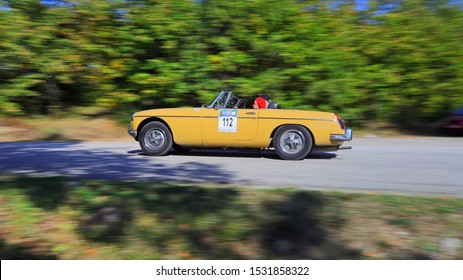 PLASTIRAS LAKE, GREECE, SEPTEMBER 28, 2019. Panning shot of classic british car MG MGB of 1972, during a classic rally at lake Plastiras in central Greece.