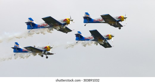 "PLASY, CZECH REPUBLIC-APRIL 27, 2013: Flying Bulls Aerobatics Team on the Airshow ""The Day on Air"". Team fly four Zli­n Z-50 LX aircraft, in the colors of Red Bull energy drink for sponsorship reasons"