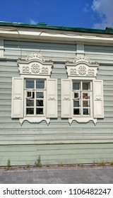 Platband, jambeau, weatherstrip on the windows: wooden, carved, old-fashioned, retro, traditional art, old wooden house
