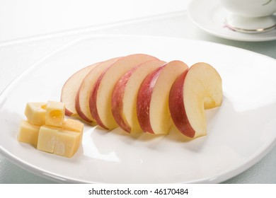 A plate of apples and cheese.