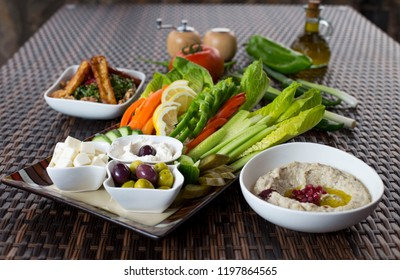 plate of arab homos with vegetables, hommos, hummus, hummos