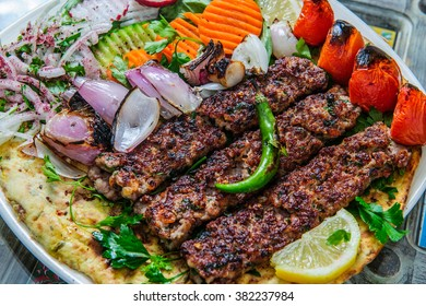Plate of arabic kebab meat with grilled vegetables.