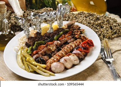 Plate of Arabic oriental barbeque, made of different kinds of meat,backed with vegetables.