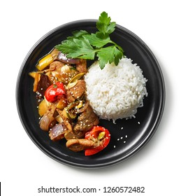 plate of asian food, rice with meat and vegetables isolated on white background, top view