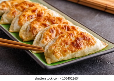 Plate of asian gyoza, dumplings snack with soy sauce.