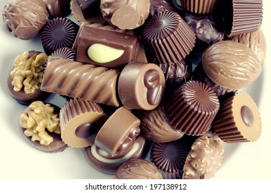 A plate of assorted light and dark gourmet chocolates.