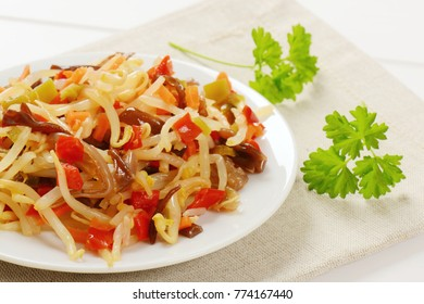 plate of assorted pickled vegetables on beige place mat - close up
