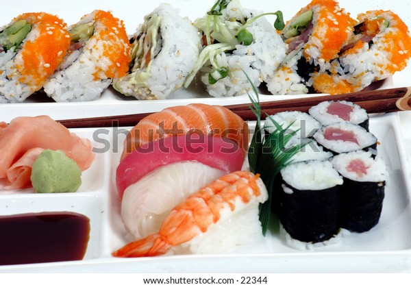 Plate of assorted sushi with Chop sticks, isolated over white