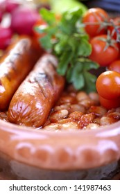 plate of baked beans and sausage