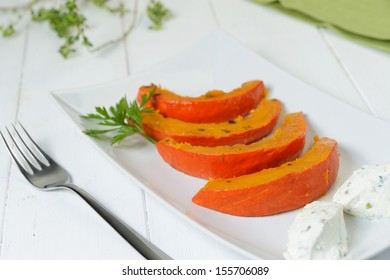 Plate of  baked pumpkin slices