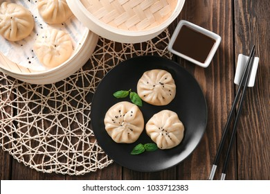Plate with baozi dumplings on table