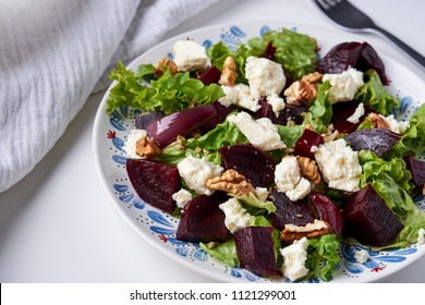 plate of beetroot, soft cheese and walnuts