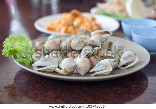 A plate of boiled delicious wing shell seafood in Thailand