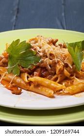 Plate of bolognese pasta. Vertical closeup shot