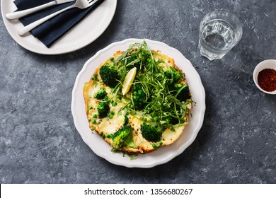Plate with broccoli frittata top view