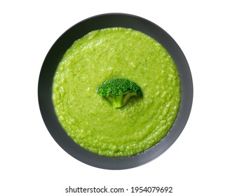 plate of broccoli soup isolated on a white background, top view