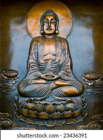 The plate of a Buddha blessing while sitting on a lotus flower