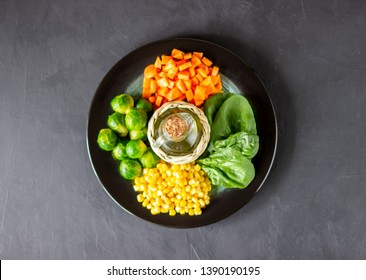 Plate with cabbage, carrots, corn and spinach. Healthy eating.