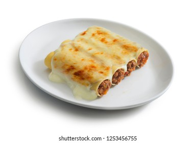 plate of cannelloni with meat sauce, typical italian food dish