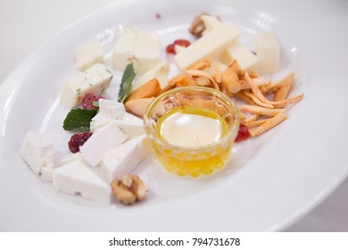 Plate with cheese in the restaurant