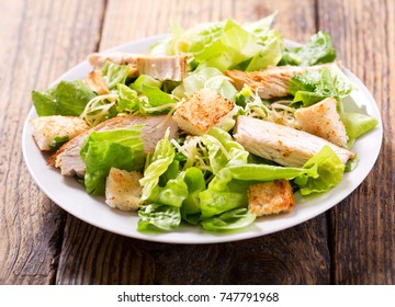plate of chicken salad on a wooden table