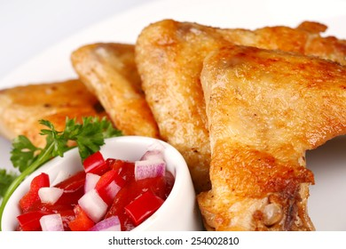 Plate of chicken wings and vegetables