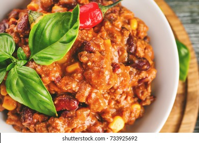 Plate with chili con carne on table, closeup