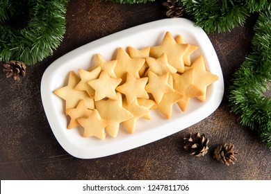 Plate with Christmas star cookies, sweet snack for kids, food for holidays