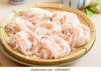 a plate of cold sakura noodles on a table