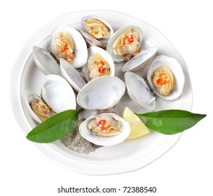 Plate of cooked clams isolated on white