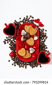 plate with cookies, candies and coffee for St. Valentine's Day, top view