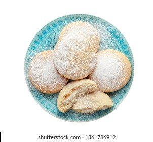 Plate with cookies for Islamic holidays isolated on white, top view. Eid Mubarak