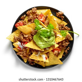 plate of corn chips nachos with fried minced meat and guacamole isolated on white background, top view