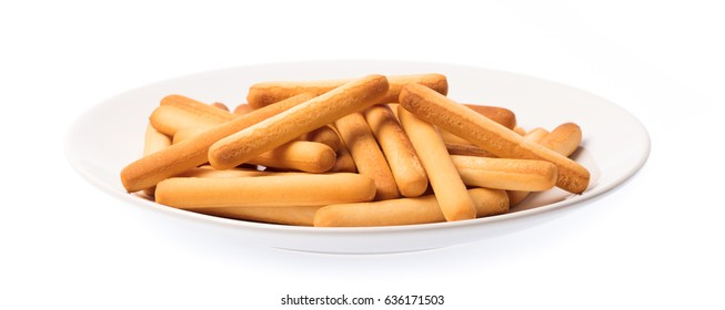 plate of crispy straw on white background. Biscuit sticks isolated on white background