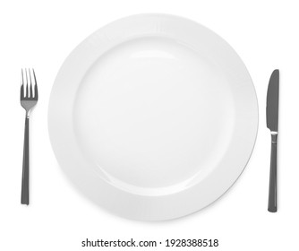 Plate and cutlery on white background, top view