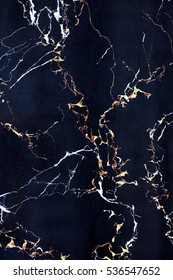 Plate of dark blue marble with cracks. Textural background.