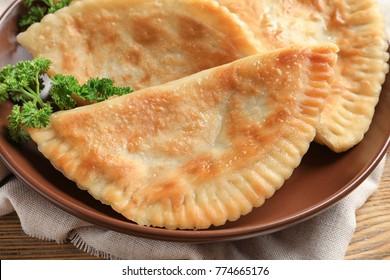 Plate with deep fried samosas, closeup