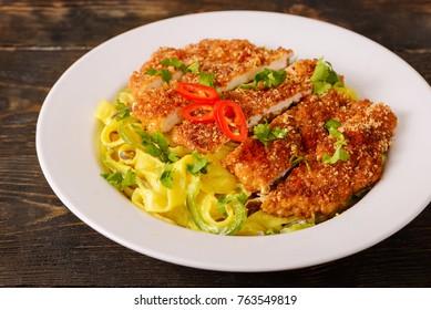 Plate with delicious Chicken Alfredo with Crispy Panko Chicken Breast