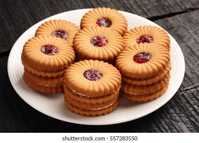 Plate of delicious cream and jam filled biscuits,