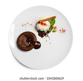 Plate with delicious fondant cake and vanilla ice-cream on white background