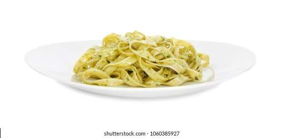 Plate of delicious pasta with pesto sauce on white background