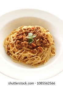 Plate of delicious spaghetti Bolognese with savory minced beef and tomato sauce